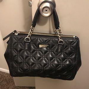 Kate Spade New York-black quilted leather handbag.